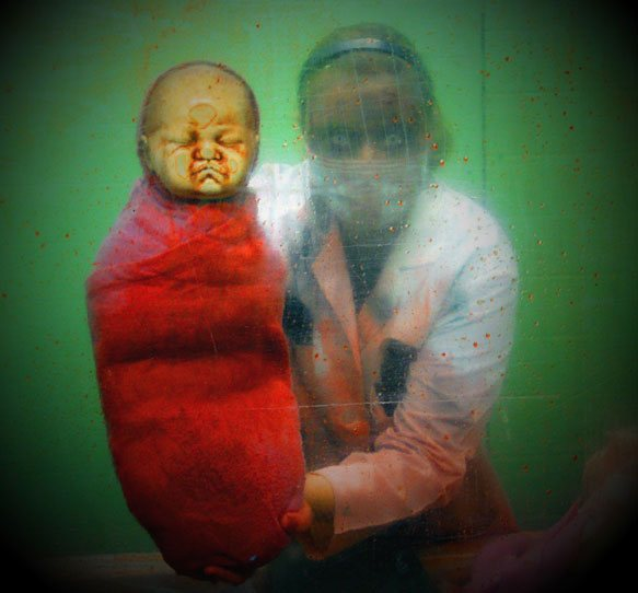 Maternity doctor with scarey baby